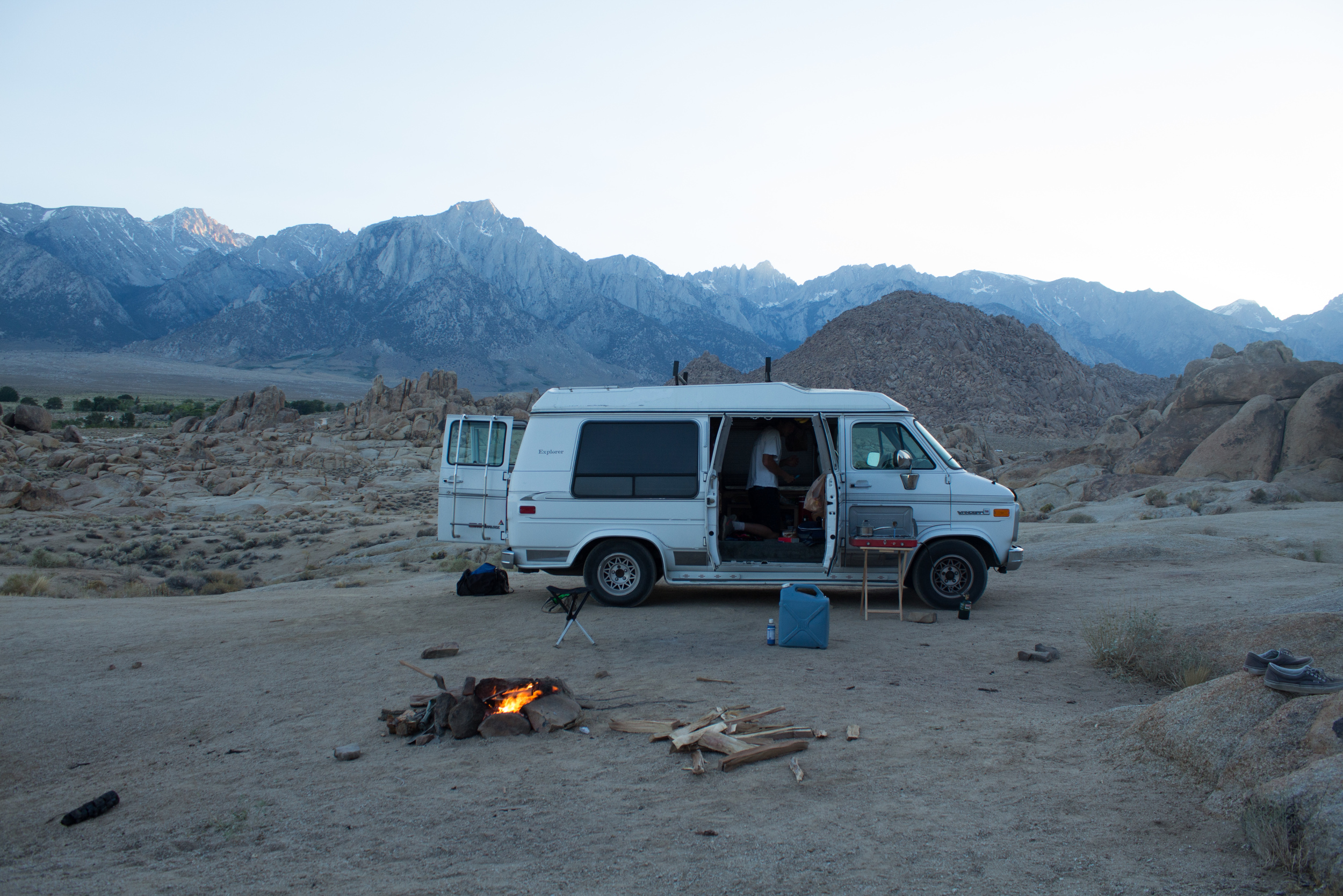 """We spent the first night sleeping at the base of Mt. Whitney in the Alabama Hills, just outside of Lone Pine, CA. Due to the beating sun, we spent the day in the mountains trying to find pools to fish. Instead, we ended up hiking more than we expected and only managed to catch a few tiny ones. After spending an hour or two playing our knife throwing competition, we called it a day and headed down the mountain in hopes it cooled off. We were sorely wrong. It was summer in the desert. Until sundown, we spent the remaining afternoon laying on rocks and playing cards in the shade. After the sun went down, we made a fire, only to realize it was still too warm, so we ended up sitting a good 20 feet away from it. When we were finally ready for sleep, we folded out the bed and popped open the sunroof.  """"I don't know if we're even gonna sleep tonight,"""" John said nervously but somewhat comically.  """"Come on, dude. It's not even that bad. We're so tired that we'll fall asleep no matter what,"""" I stated, in hopes of getting up our spirit.  As I laid down on the leather sofa with the thinnest blanket I could find, my eyes stared at the ceiling and I began to break a sweat. """"Yeah... This is gonna be a long night."""""""