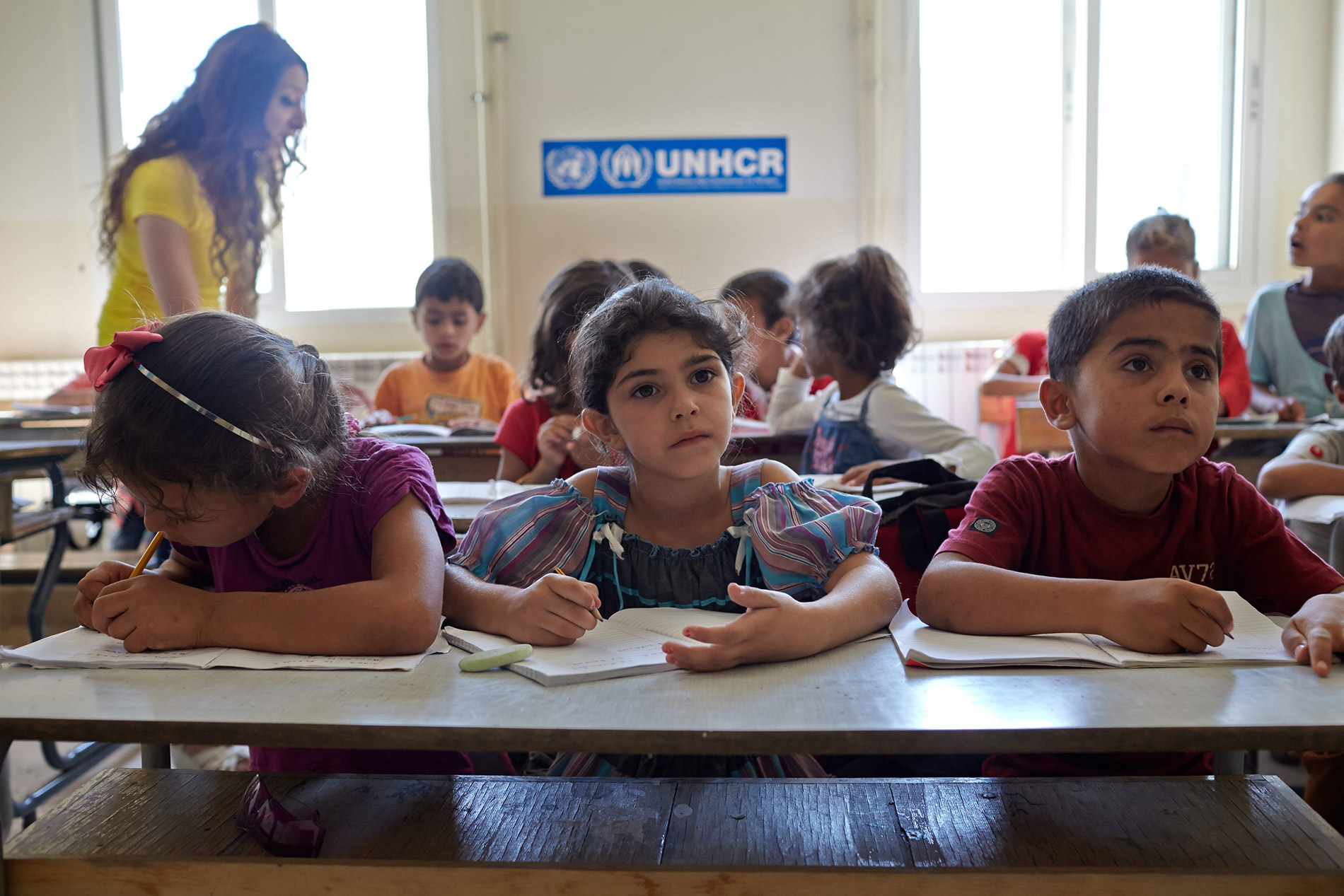 Refugee children in a classroom in a camp run by the United Nations High Commissioner for Refugees, or UNHCR.