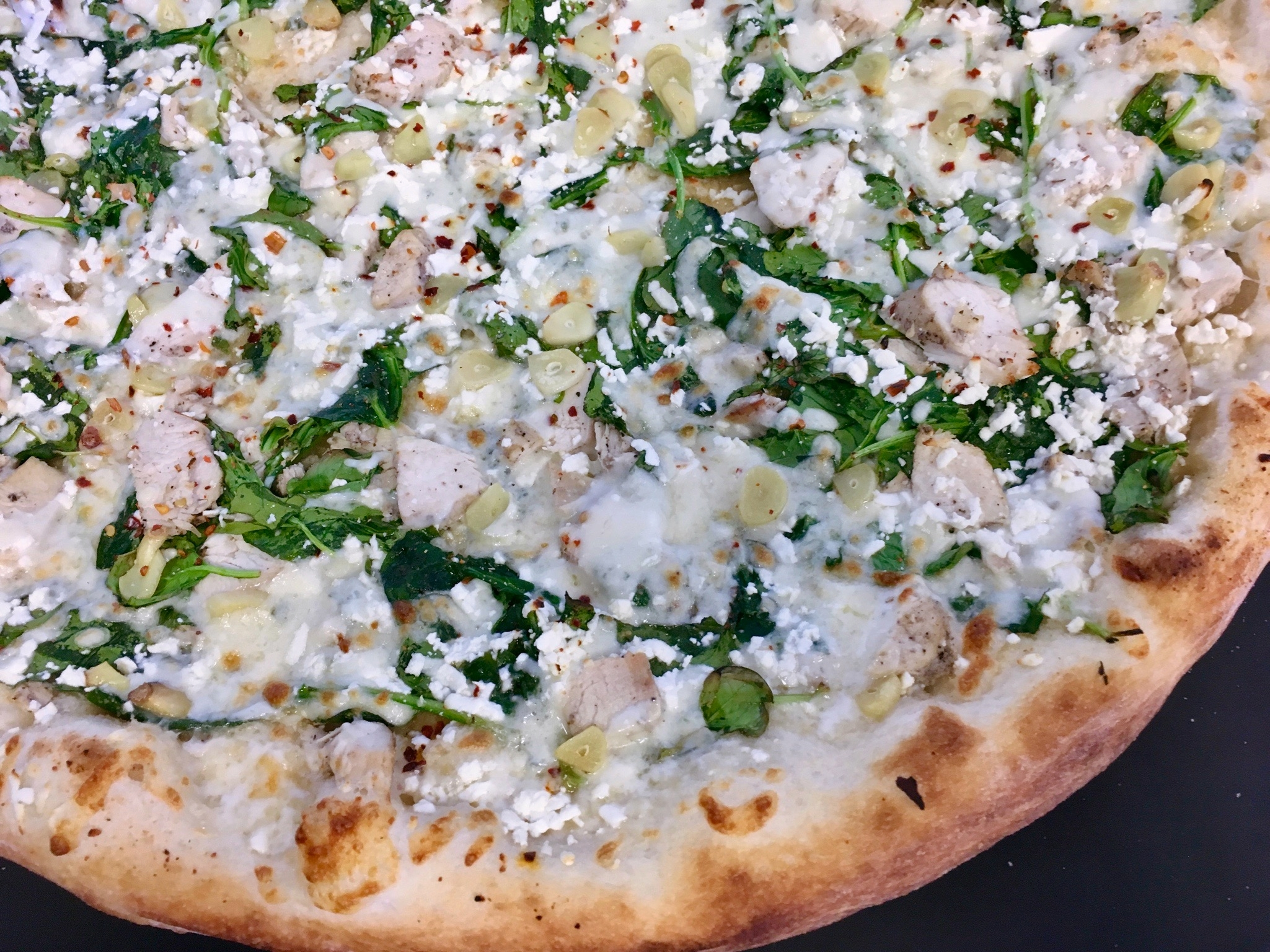 Spinach Roasted Garlic Chicken Pizza