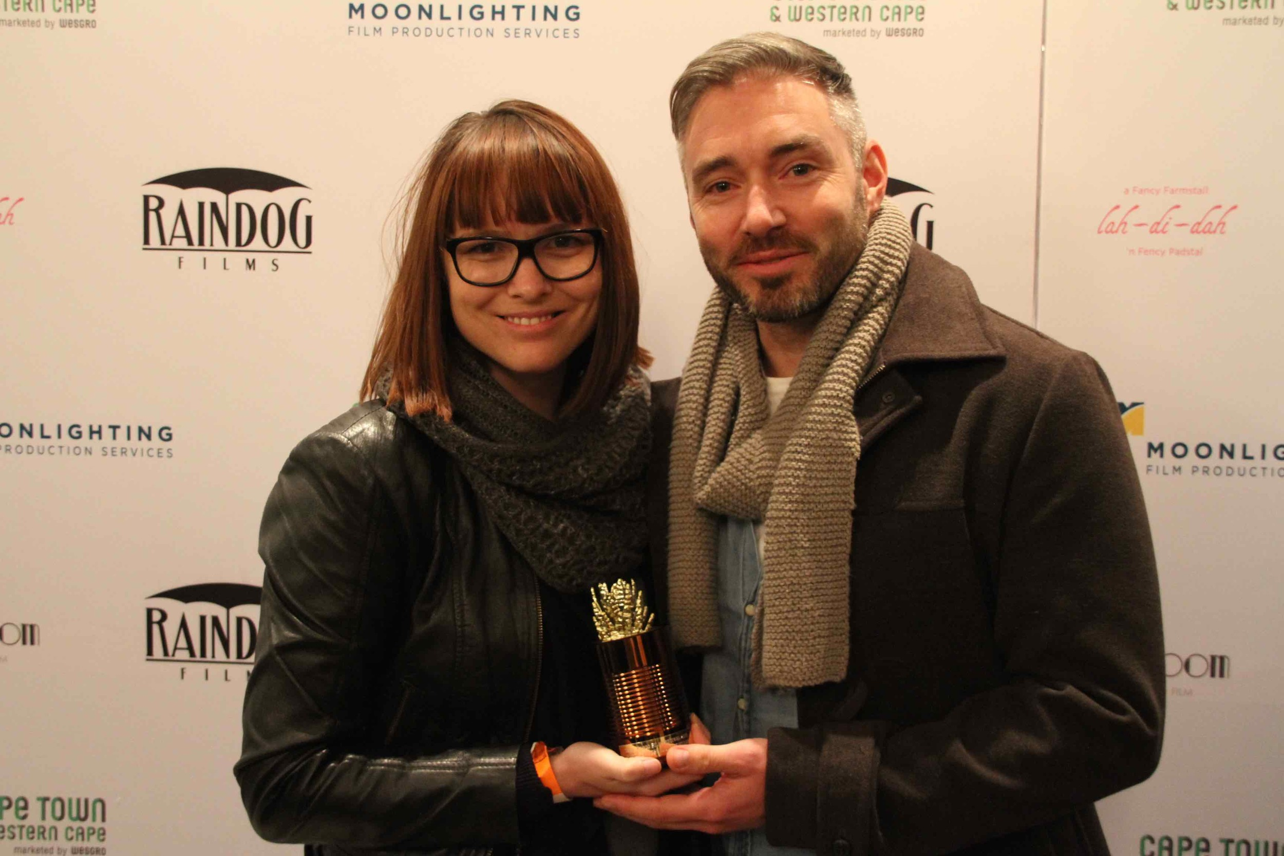 2016 Best Feature Documentary Winners Kelly Scott and Richard Finn Gregory in front of our Sponsor & Supporter Photo Wall
