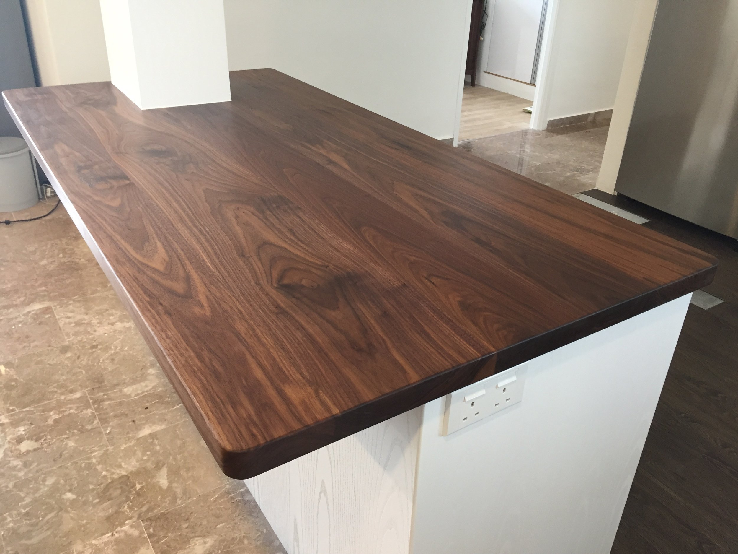 Solid Wood top in natural oil finish can be a great show piece, especially when used as an island top