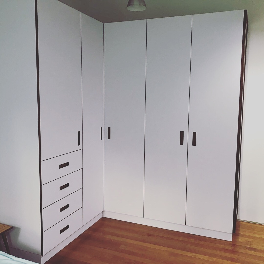 The finished wardrobe is spacious, modern and bright.