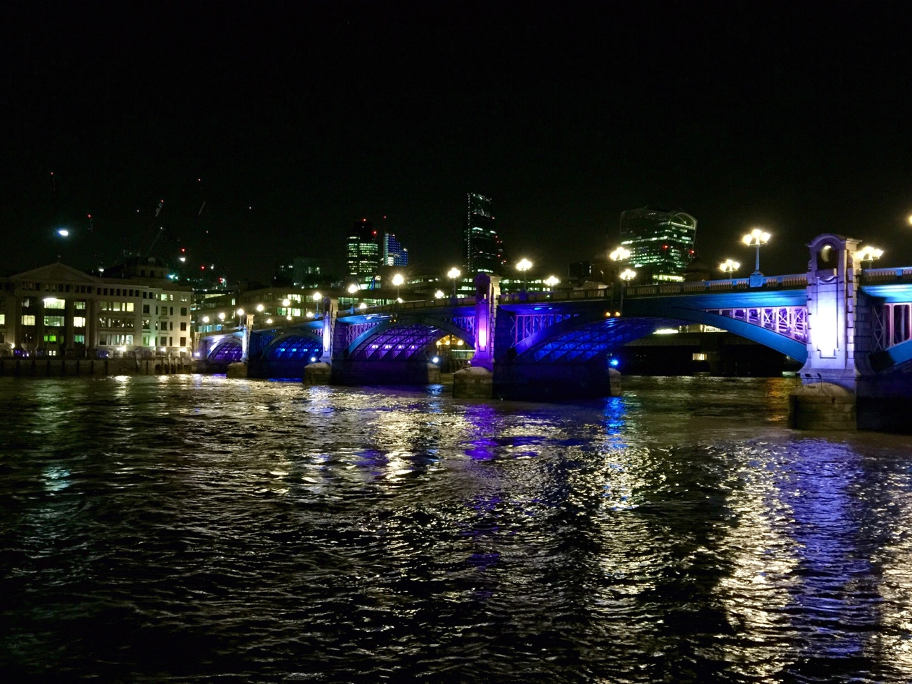 London Cityscape from the Thames at Night - London, United Kingdom    After leaving the globe, there was a charity moonlight walk happening along the Thames. I walked alongside a few fellow travelers for a few miles before turning off to take the underground back for some much needed rest. London glitters at night, and the reflections cast along the riverside make it unlike any other city that I have ever been to. This is the first time in my life that I have ever wanted the sun to set earlier so I can experience it again.