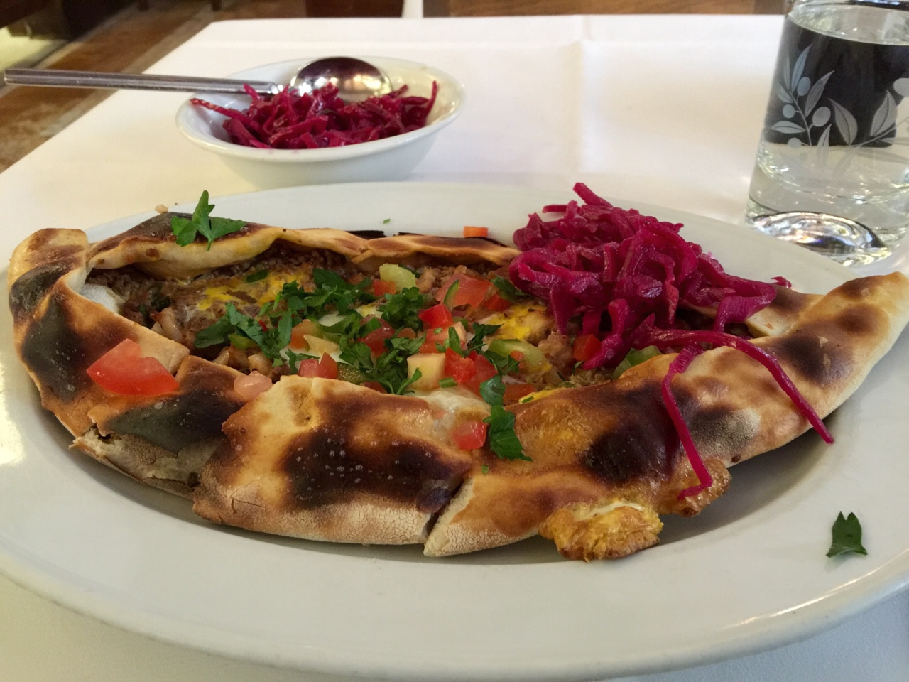 This is a Pide, a Turkish dish from the gem of a restaurant (Tas Pide) that I found near the Shakespeare Globe theatre. Delicious!