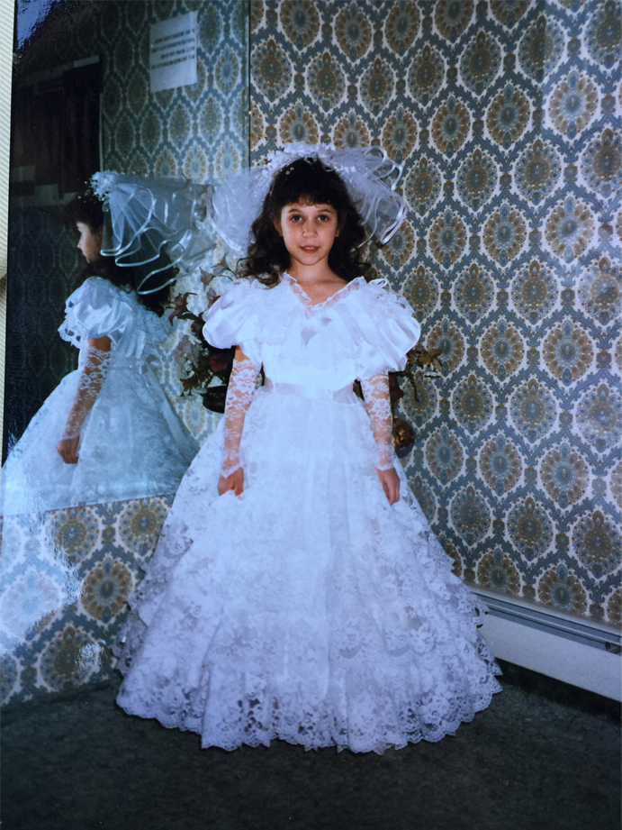 Beth Starting Her career at bridal chateau modelling flower girl dresses. Picture circa 1988.