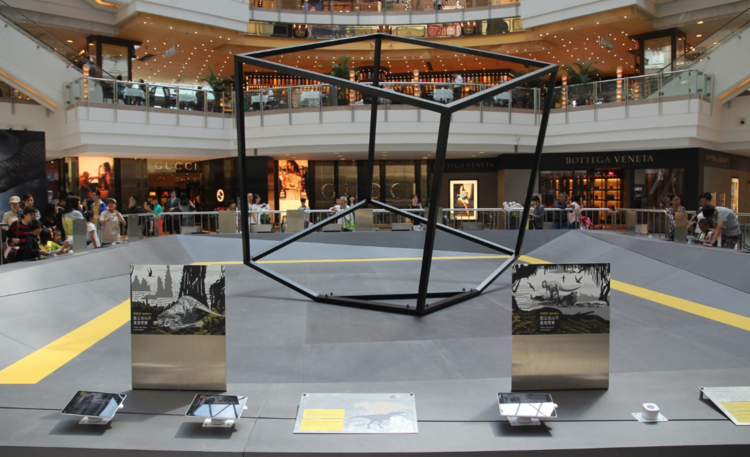 The set design in Asia with a large center cube surrounded by trigger images