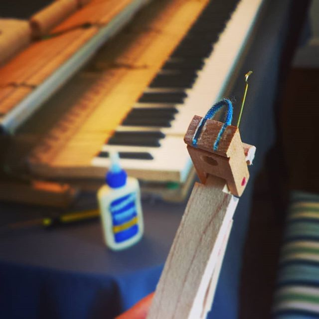Let the tinkering begin! Here's the first little action repair on the new-to-me Wurlitzer grand. Just a little dab of glue to get that string back in place... :)