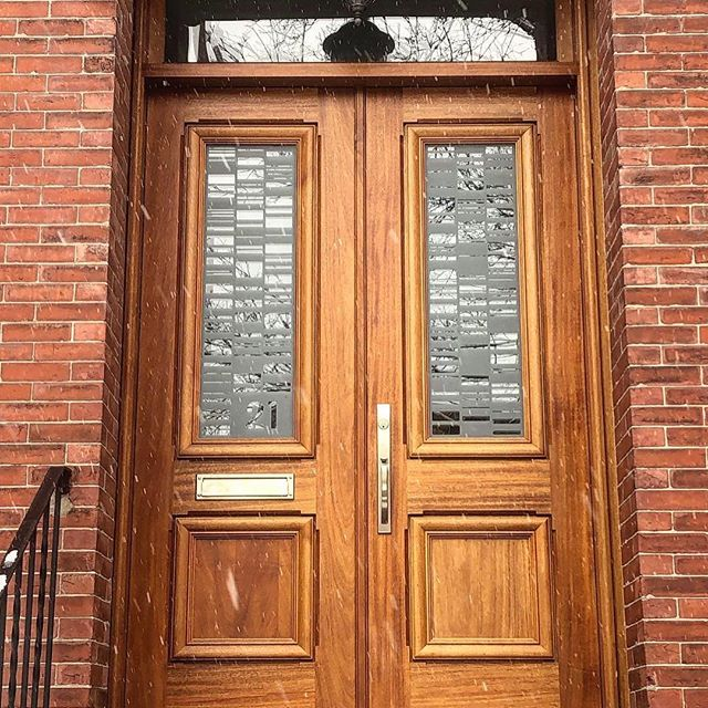 Snowy day - Pair of Mahogany doors with transom from a few summers back for a Cambridge row house - wild etched glass #woodworking #millwork #architecturalmillwork #doorsofinstagram #door #finewoodworking #cambridge #boston #finishcarpentry #carpentry