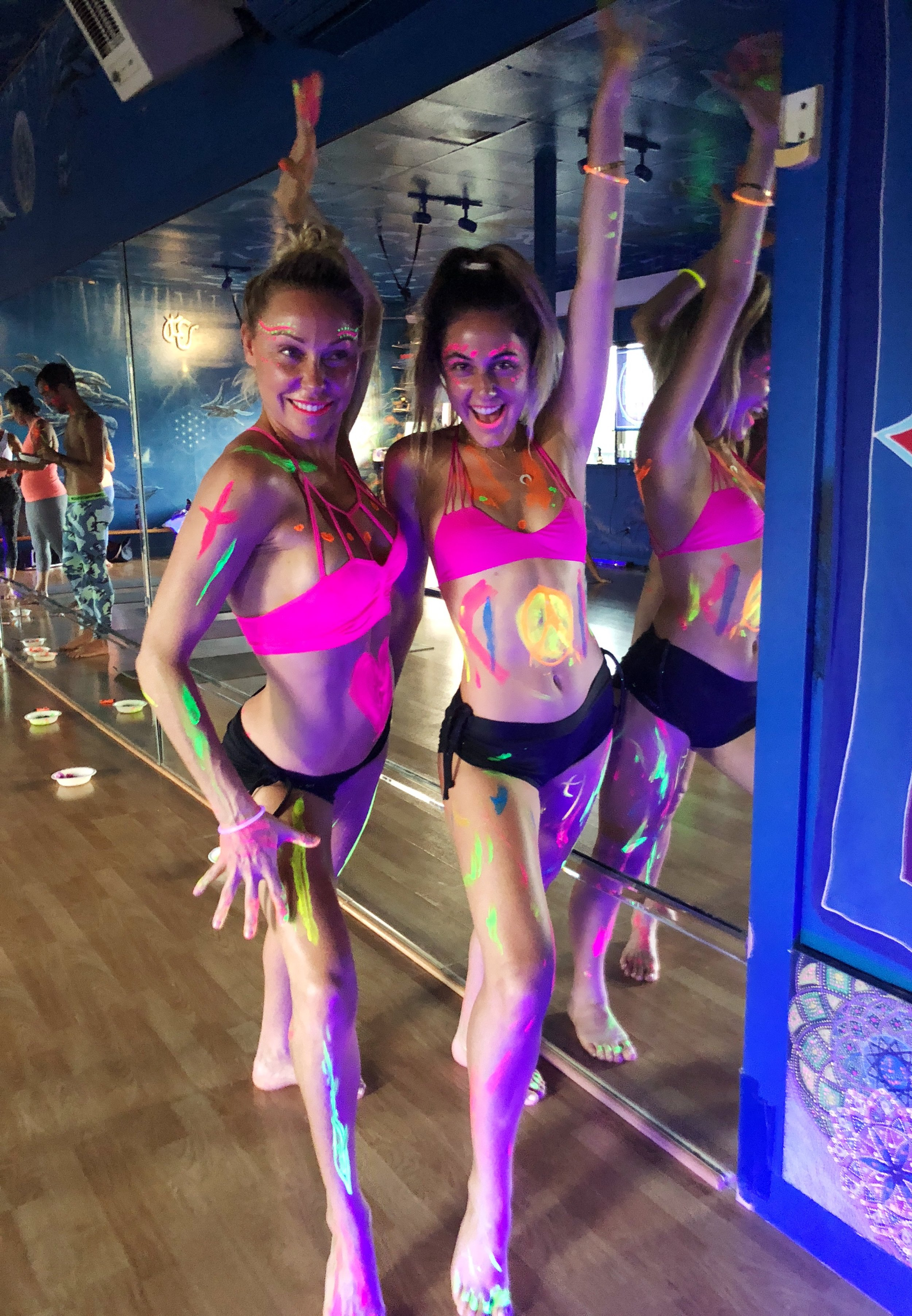 This is my mom and I at Maui Hot Yoga. They had an insane neon black light yoga class!