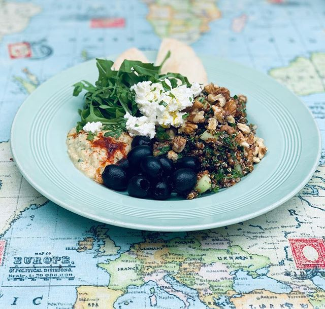 A Lebanese inspired Mezze plate: red quinoa tabbouleh with mint, parsley, cucumbers, cherry tomatoes in a lemony olive oil dressing with black Kalamata olives, lemony hummus, served with rocket and optional feta and pita. Come and enjoy in our sunny garden 🦋🌸🌿 #coffee#cafe#garden#healthy #mezze#salad#newcross #newcrossgate