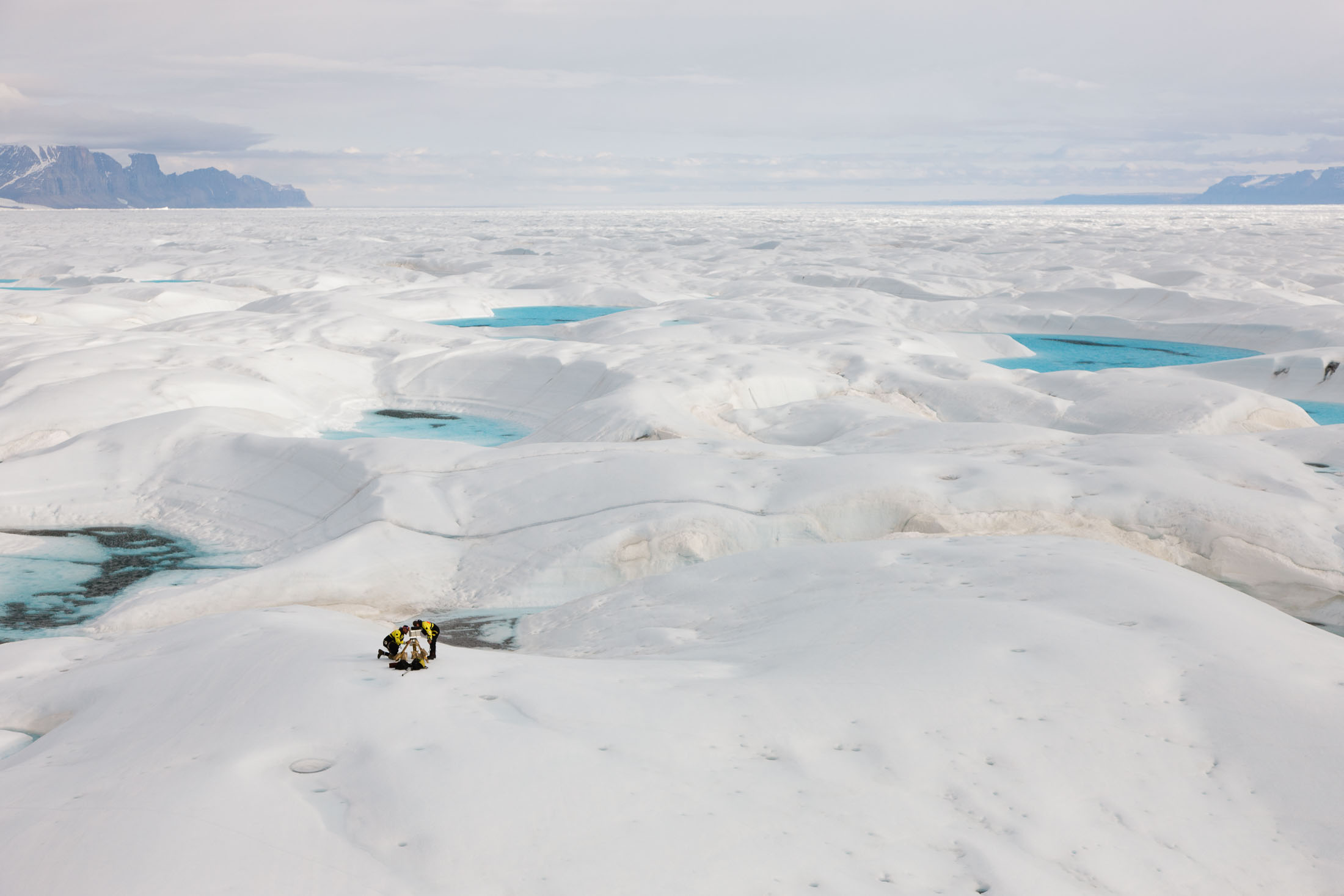 Scientists on the surface of a glacier on Greenland