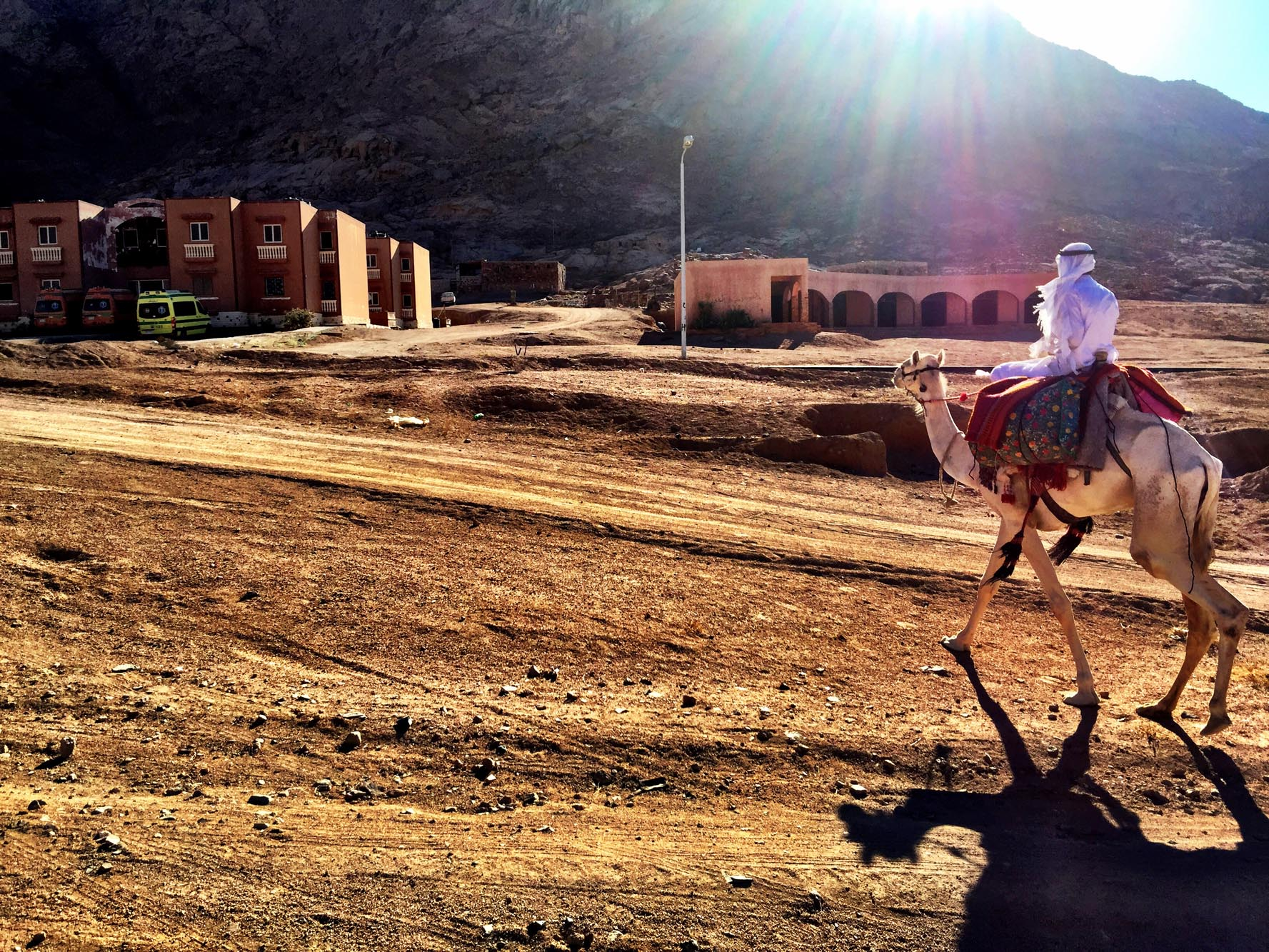 Mohamed riding to the village at sunset