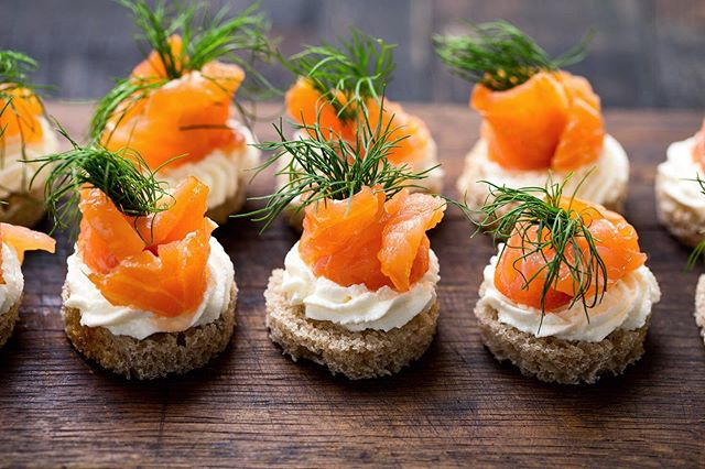 Impress your guests right off the bat with our Salmon Herb Canapés. This savory combination of rye, cream cheese, herbs and smoked salmon is an explosion of flavor. Don't show up late, because these will be gone fast.  For the recipe, go to MaximumLiving.live