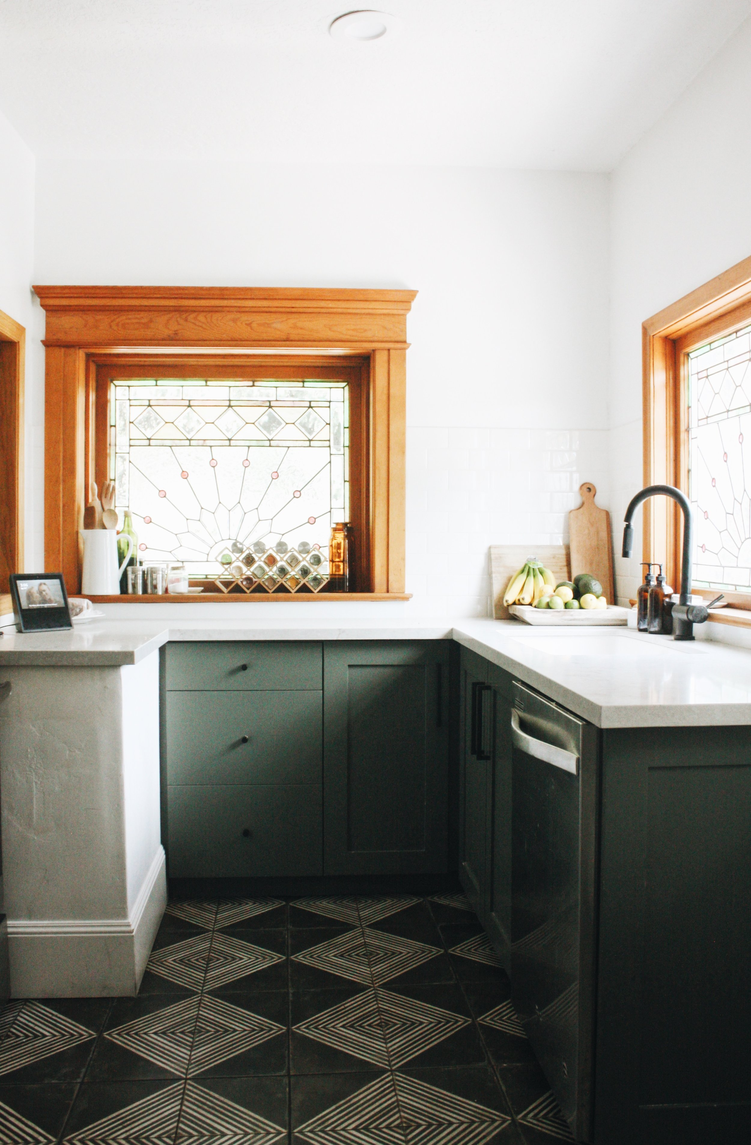 Paint color on cabinets is Basil from Sherwin-Williams