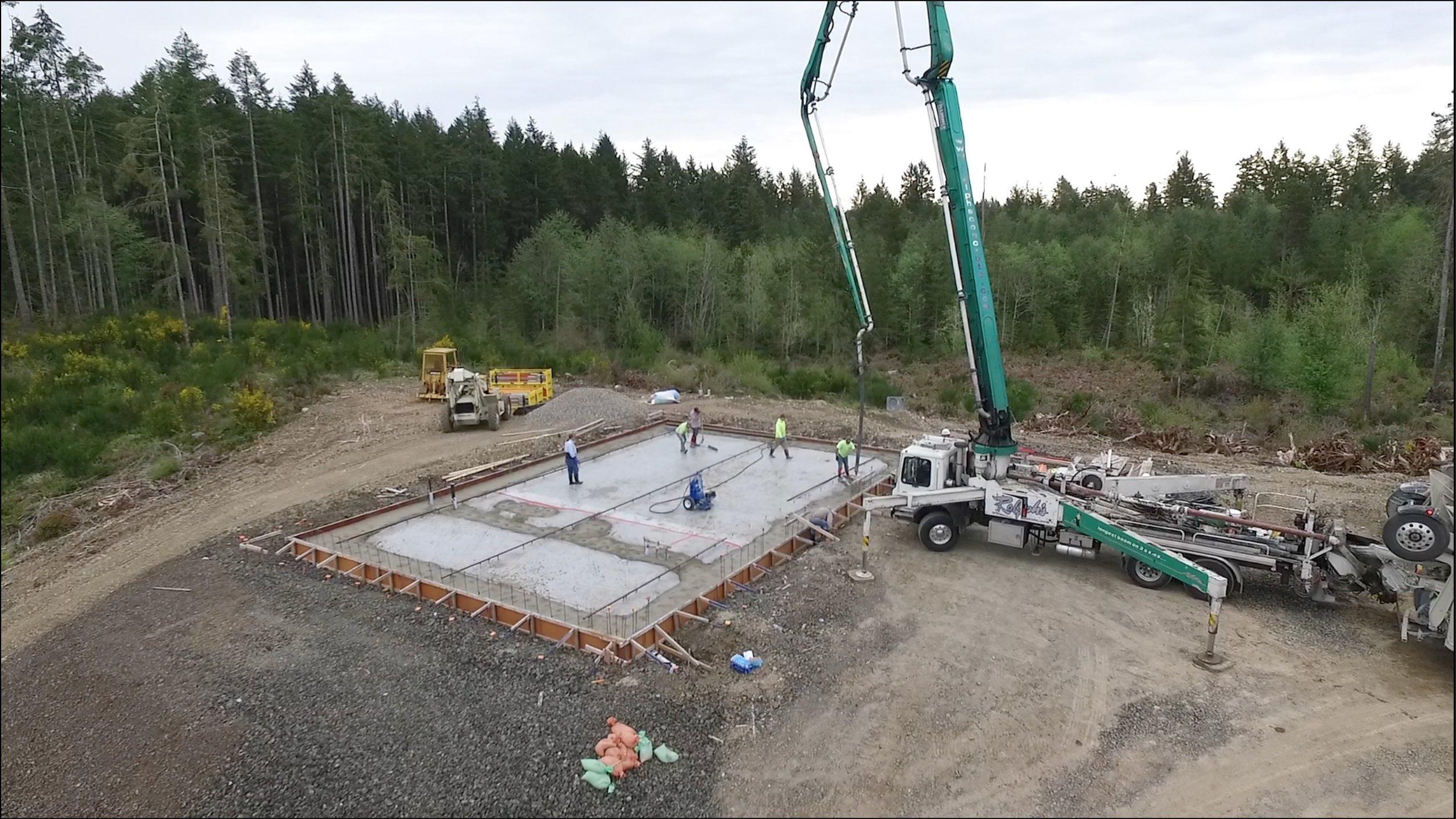 Concrete slab being poured for the shop. (c) MACNAK Construction