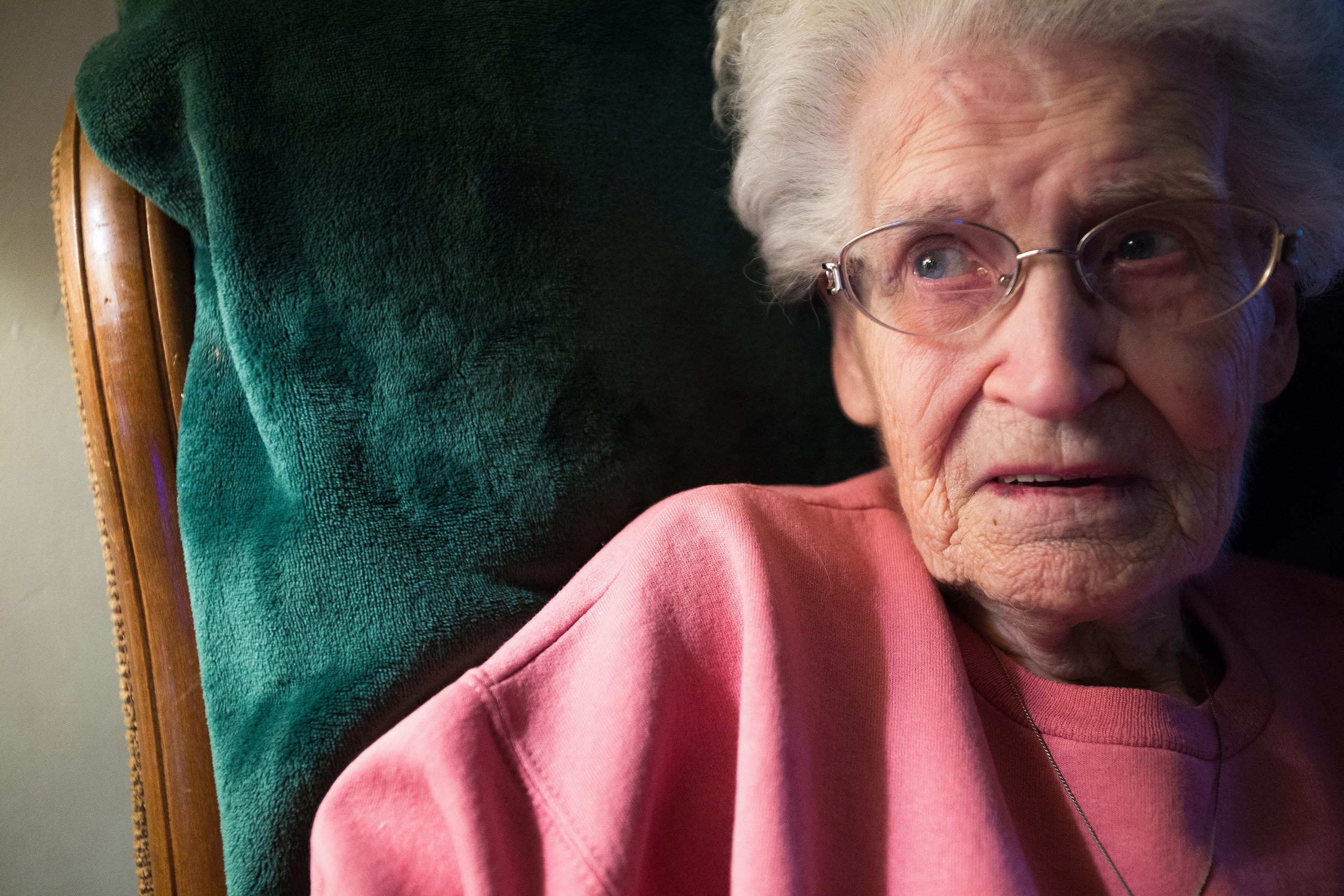"From the rocking chair in her living room, Deloris Pohl, 89, looks off into distance. ""He was going out to the car the other day and his knees were giving out on him and I was afraid he was going to fall and I said 'Howard Pohl don't you dare fall on me because I can't get you up,'"" said Deloris. ""And then I keep thinking, well if I fall and get hurt, whose gonna.. you know, so I have to do a lot of things with a grain of salt."""