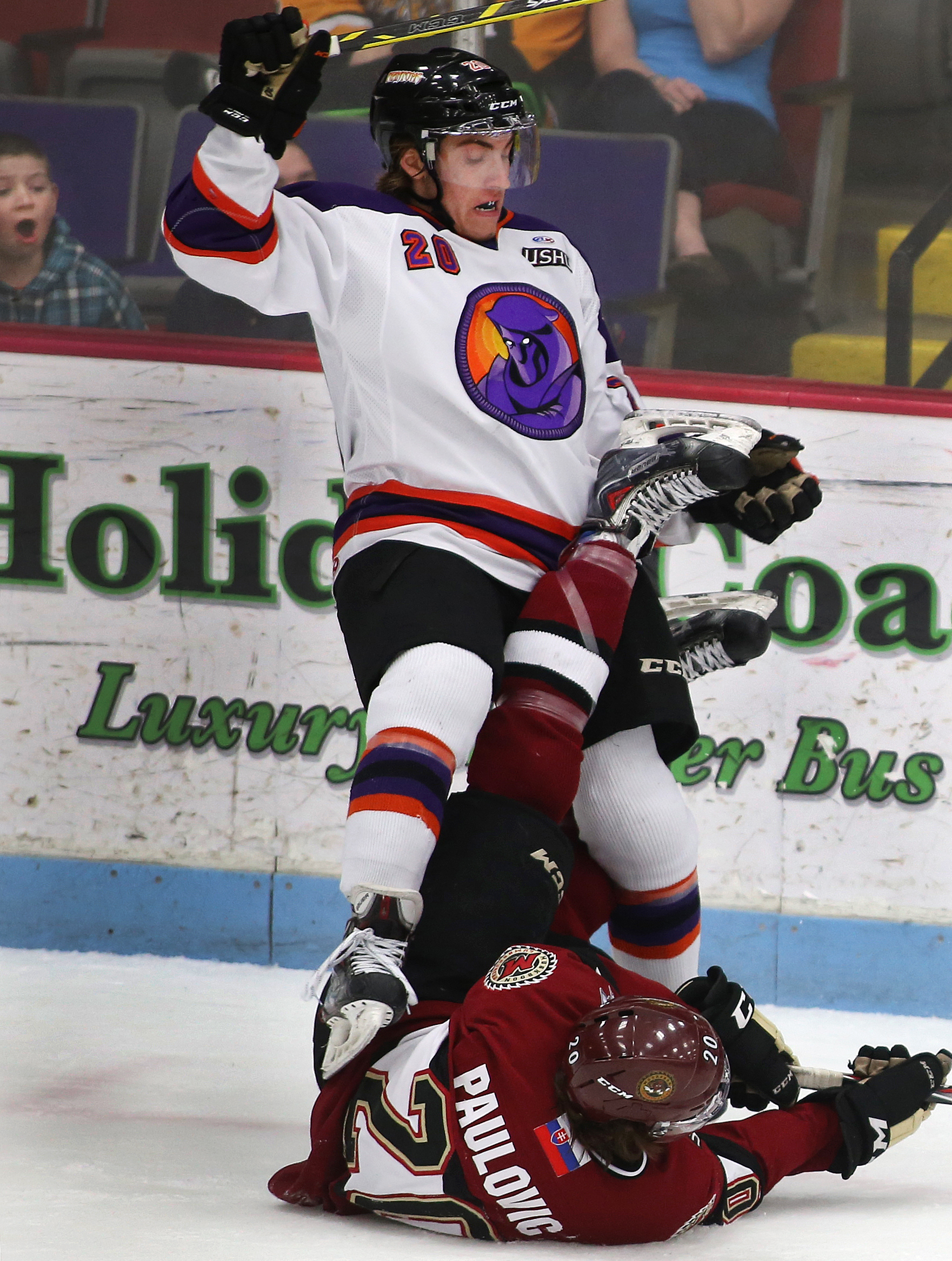 Lukas Craggs (20) of Youngstown collides with Matej Paulovic of Muskegon before called for a penalty in the first period of the USHL playoff opener game at the L.C. Walker Arena Wednesday, April 15, 2015. Muskegon won 5-4 in overtime.