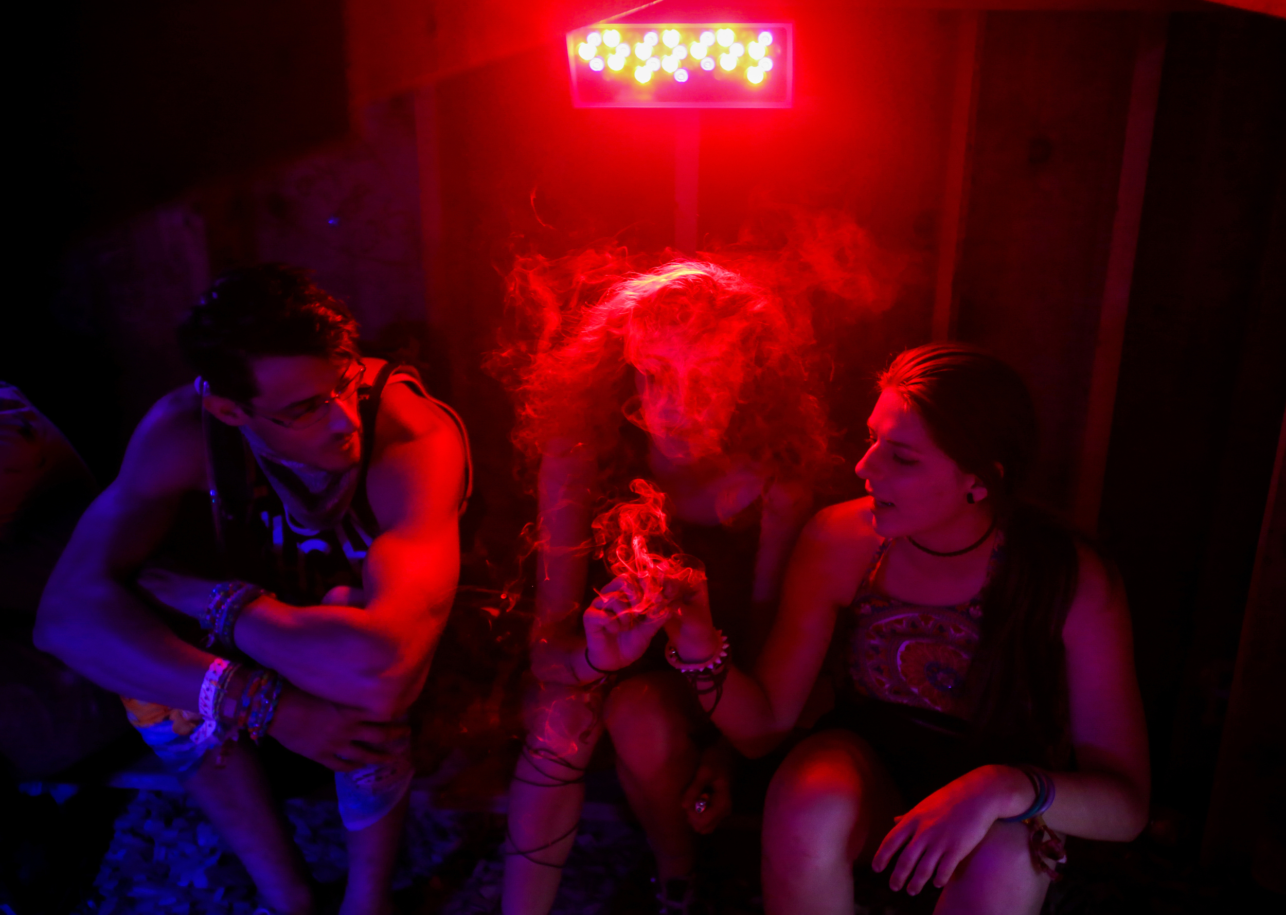 Festival goers smoke marijuana in the bottom of a four-story tree fort in the Sherwood Forest during Electric Forest on Saturday, June 27, 2015.