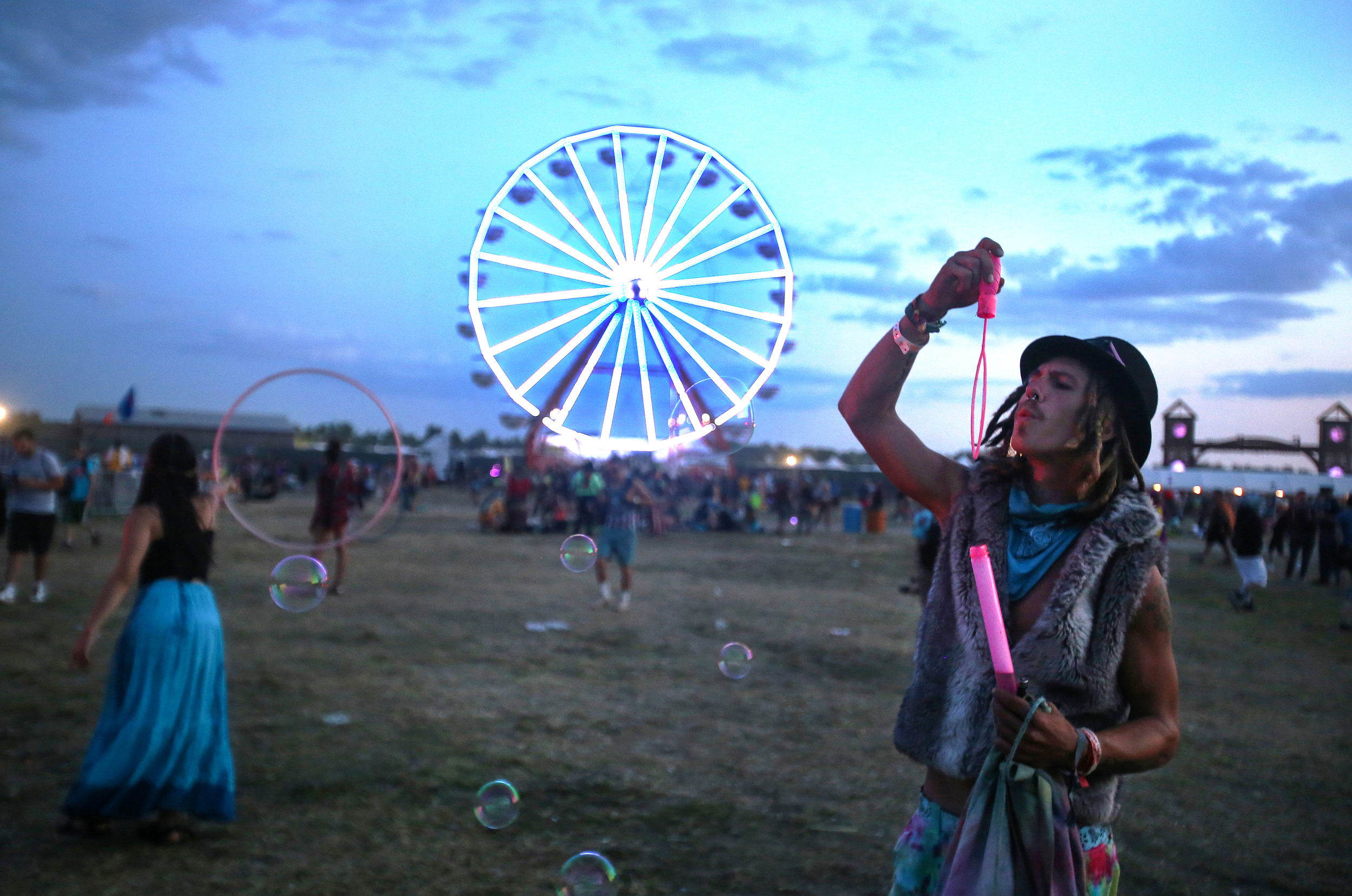 A festival goer blows bubbles as MJ Cole performs at Tripolee in Electric Forest on Saturday, June 27, 2015.