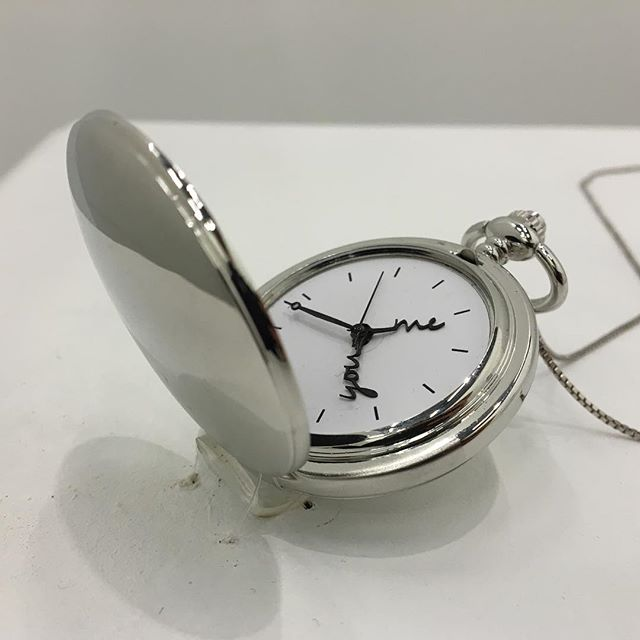 """Long distance."" Pocket watch, paper, necklace chain. Two hour hands move around the clock together, never catching one another until the wearer resets."