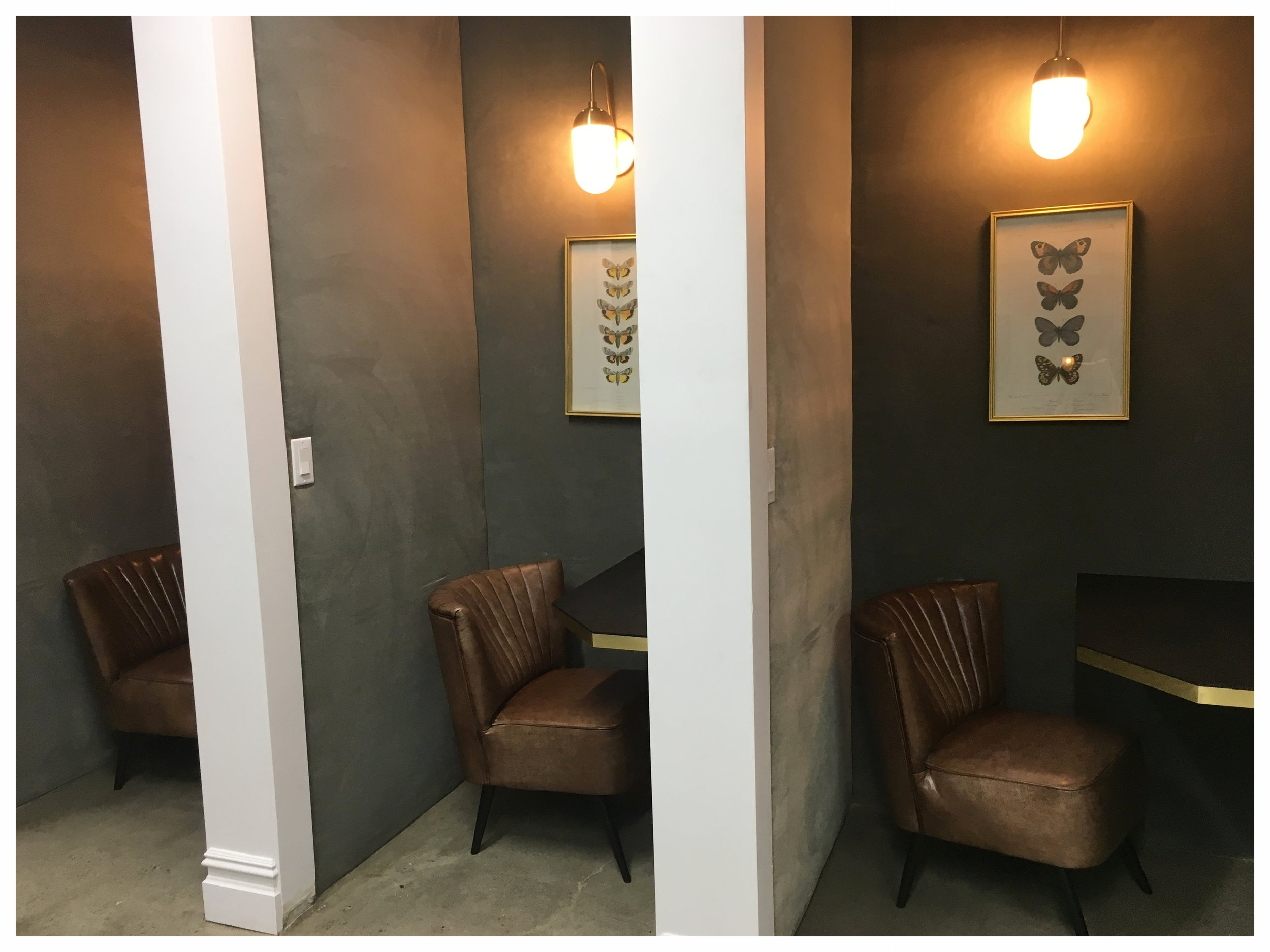 Fig 4A: Phone booths (glass doors to come) near the front desk.