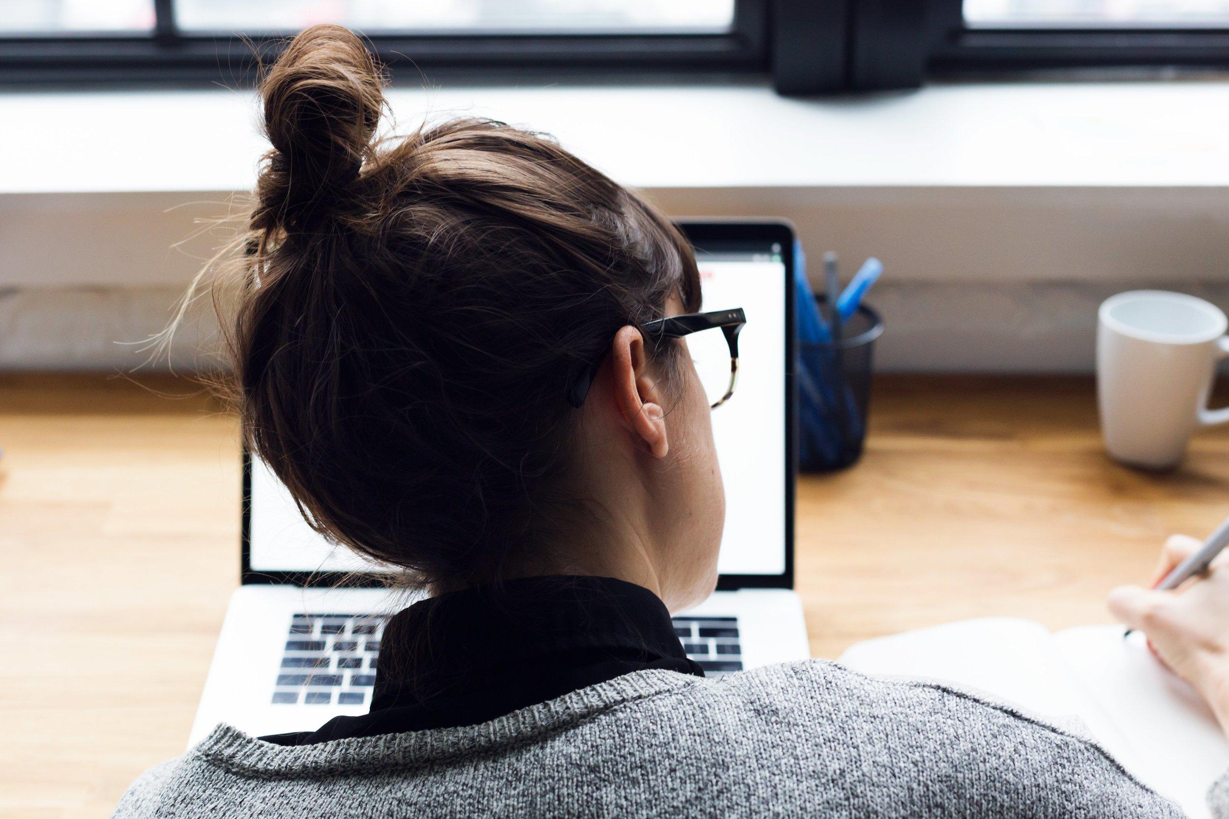 female-taking-notes-and-browsing-laptop_4460x4460.jpg