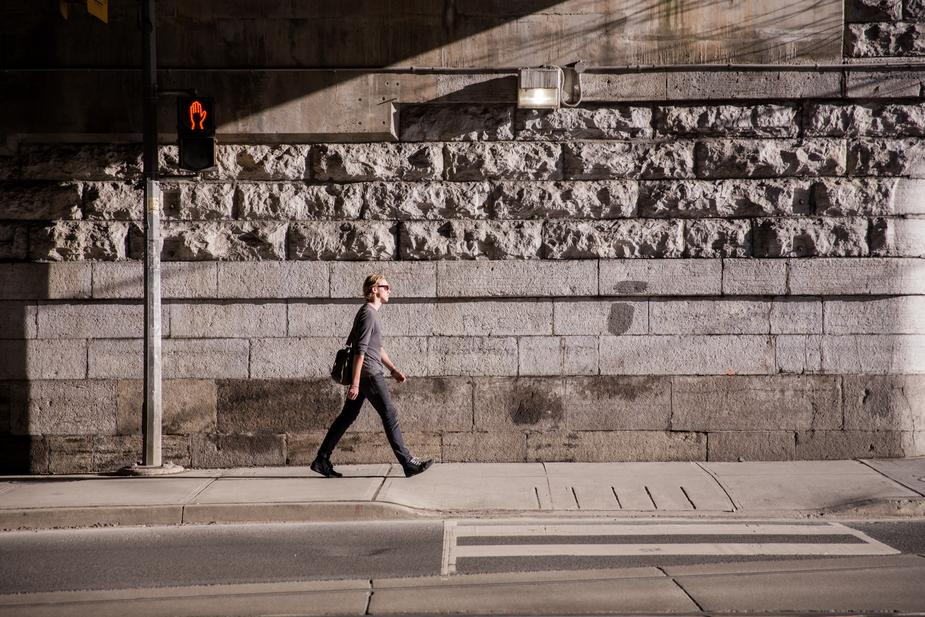 business-man-walks-in-urban-sunlight_925x.jpg