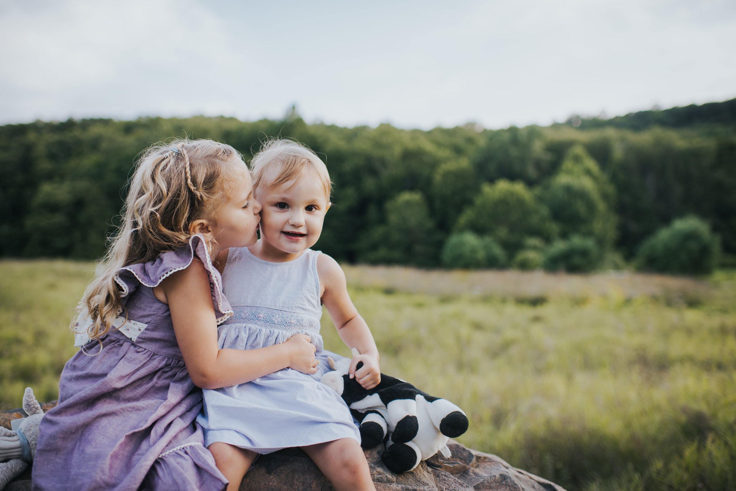 Sisters playing in Southbury, Connecticut Kendra Conroy Photography