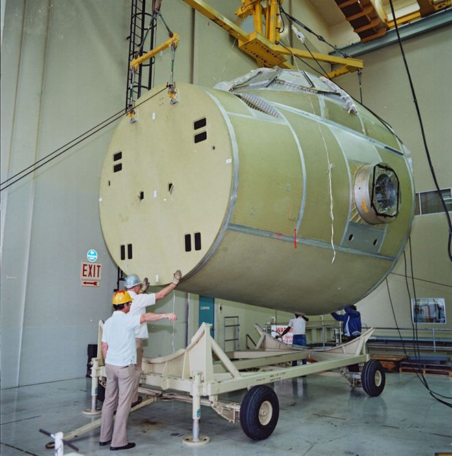 Atlantis' crew module is moved to the vacuum chamber test cell at Rockwell's Downey facility on March 30, 1983..jpg