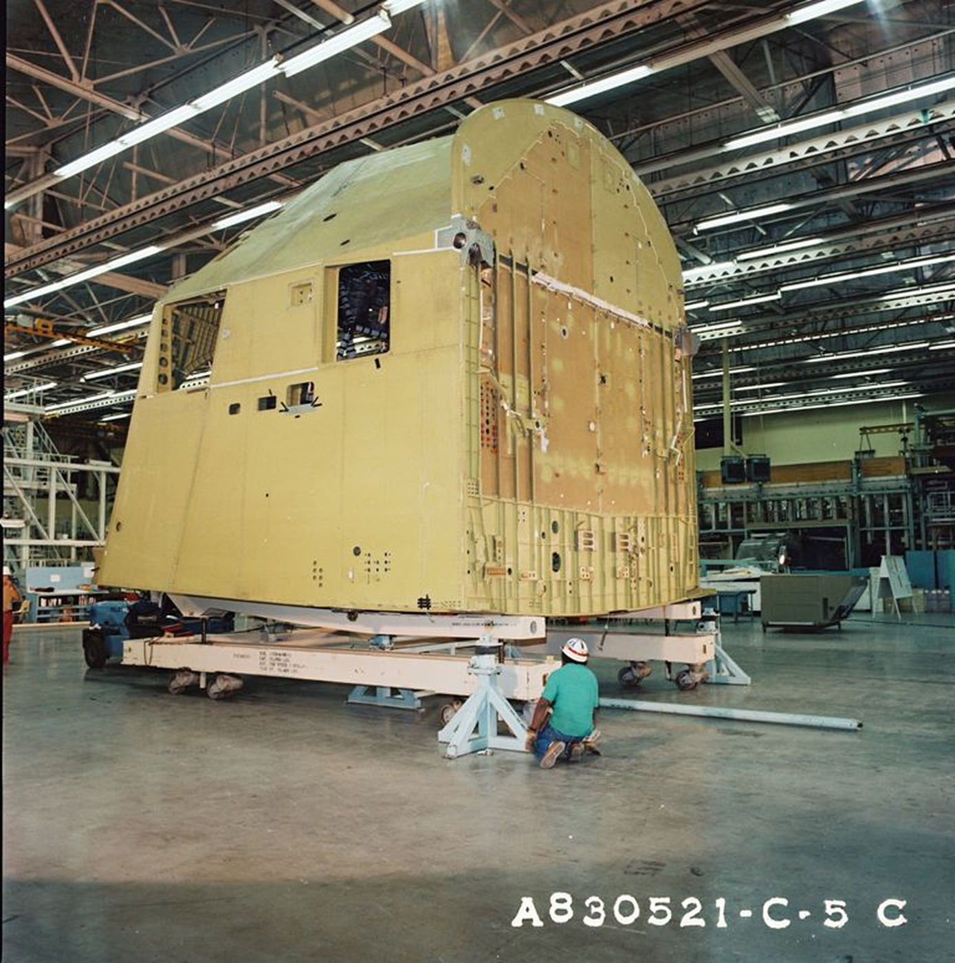 Preparations continue on Atlantis' aft fuselage for its delivery to Rockwell, Palmdale from Rockwell, Downey in May 1983..jpg