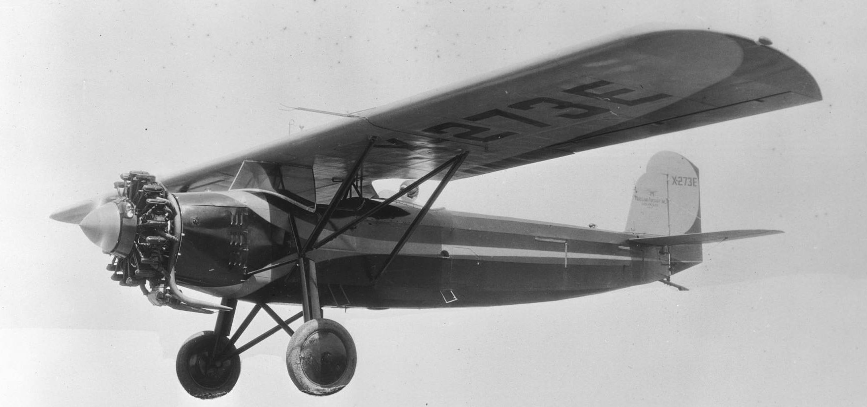 Monoplane in flight near Mines Field factory, 1929