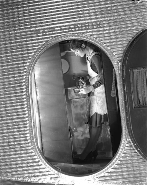 A hostess serves tea on a Transcontinental Air Transport (TAT) flight, Oct. 19, 1929.