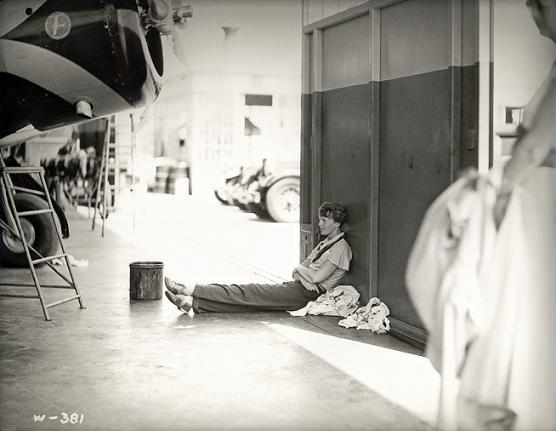 Earhart on factory floor, Lockheed Aircraft Co., Burbank, ca. 1930
