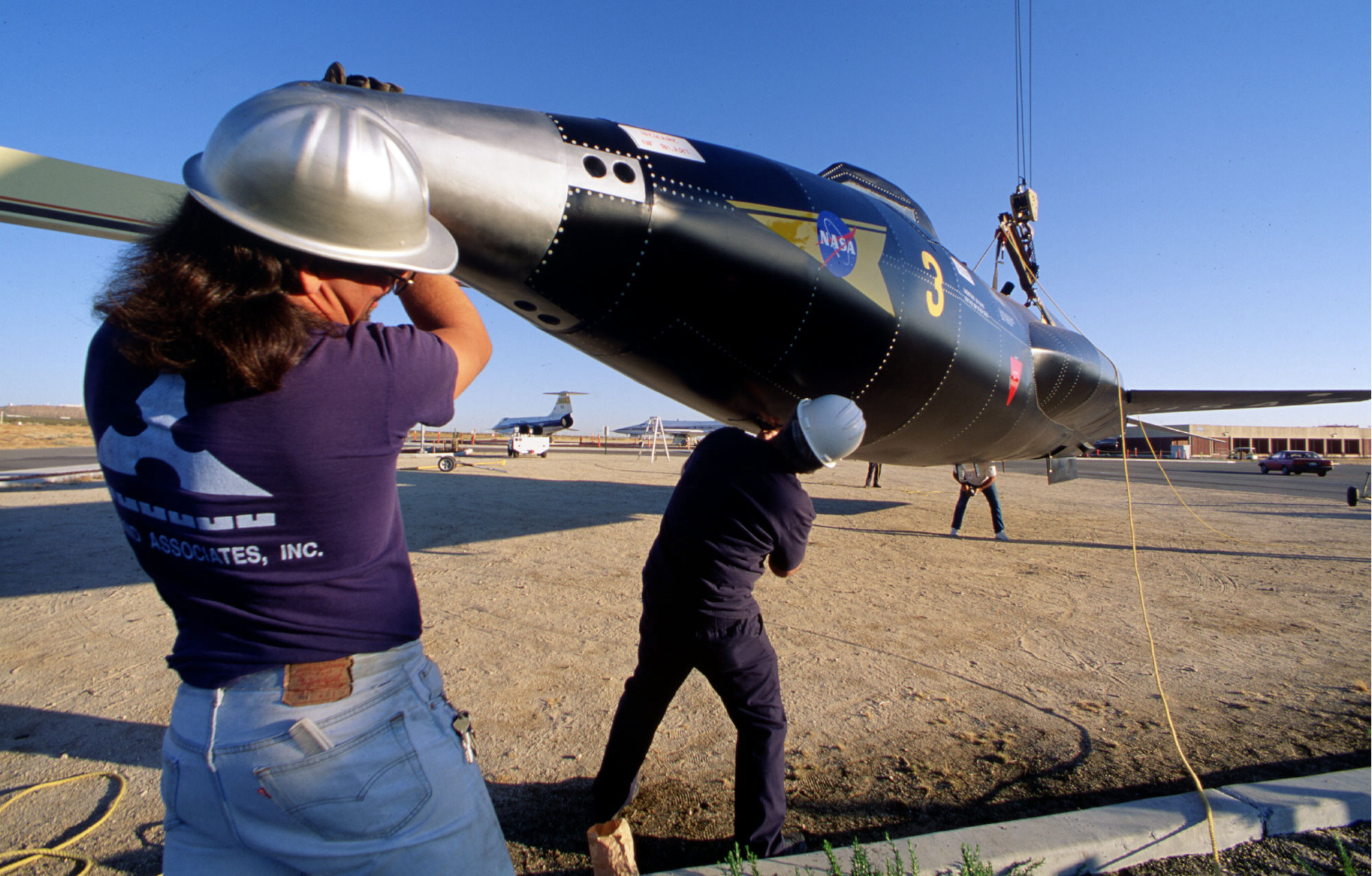 Workmen installing X-15 full-scale metal mockup. (NASA)