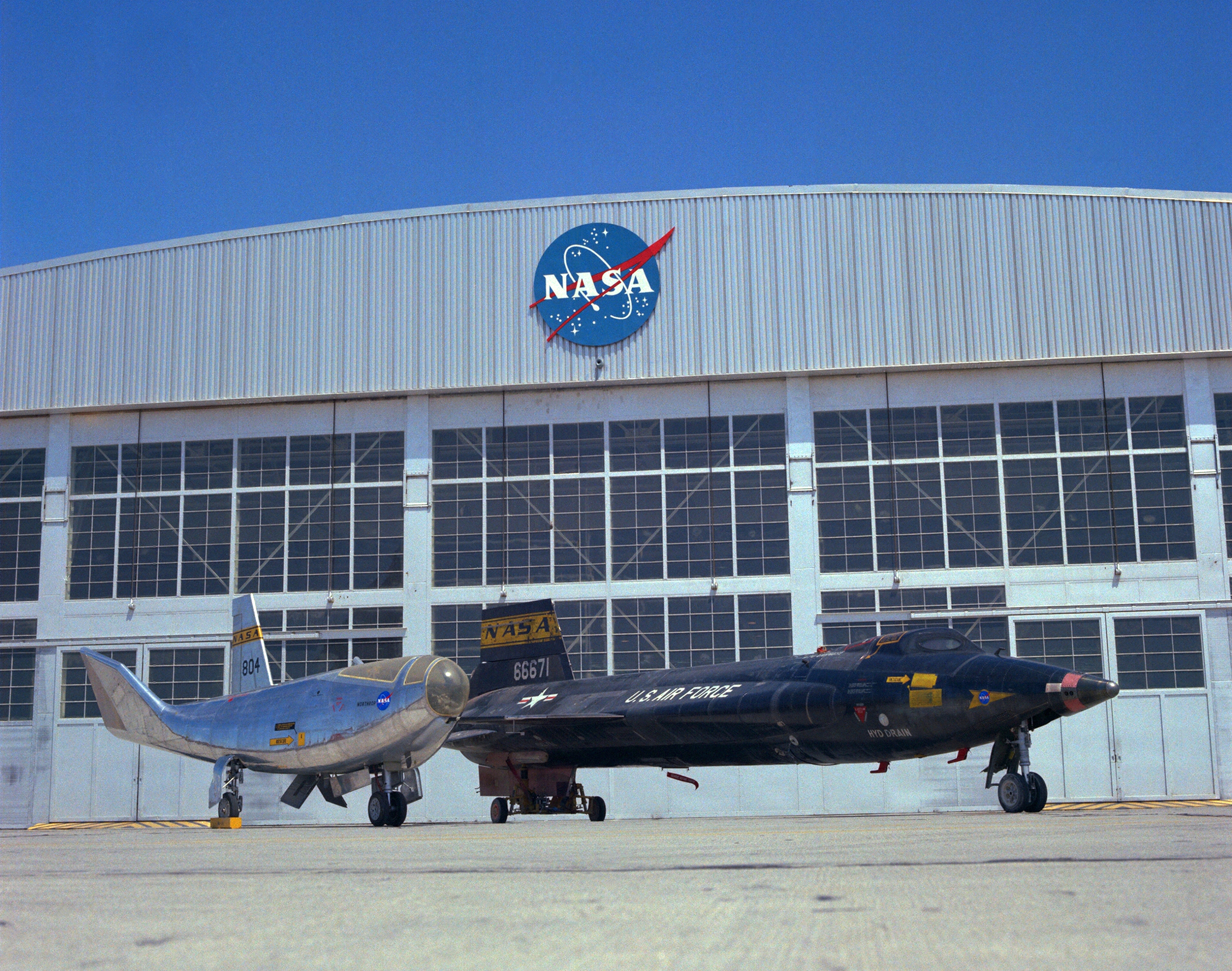 X-15 and HL-10 parked on NASA ramp.