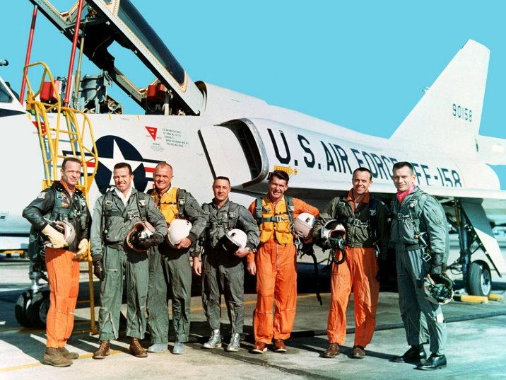 Mercury astronauts standing beside a Convair 106-B aircraft