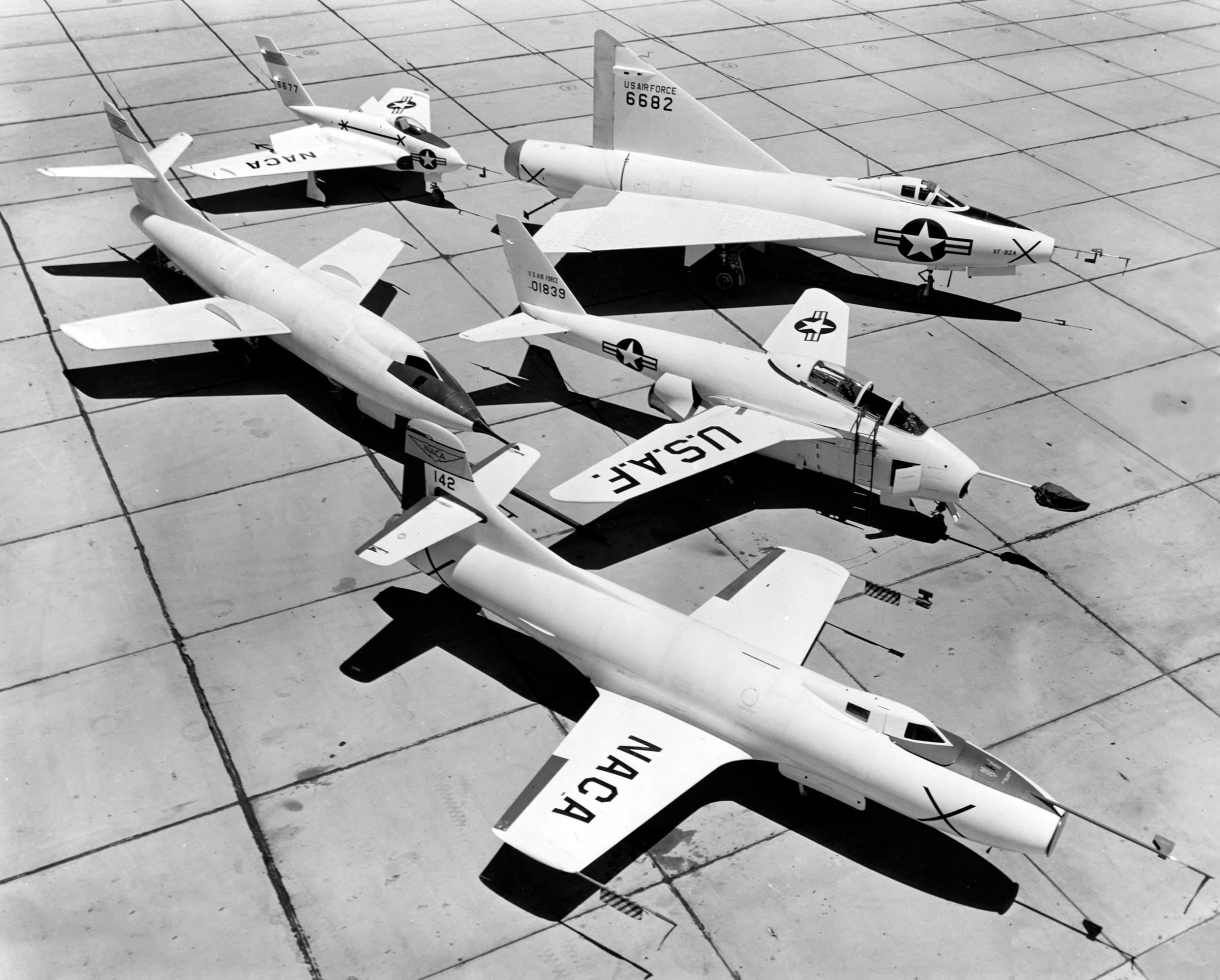 A posed group portrait of early X-Planes at the NACA High-Speed Flight Station in August 1953.