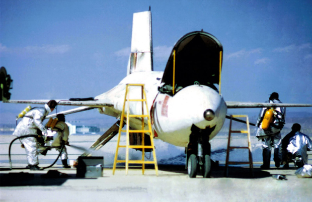 Fire crews extinguish the fire under the X-15A-2 after Knight's landing.
