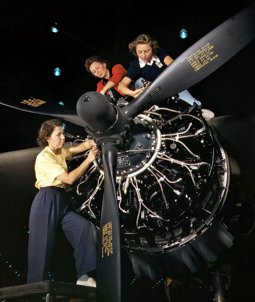 October 1942. Engine installers at Douglas Aircraft in Long Beach, California.