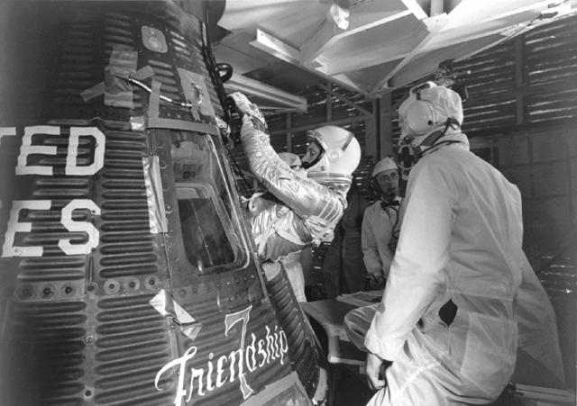 GPN-2000-001029 Glenn Enters his Mercury Capsule