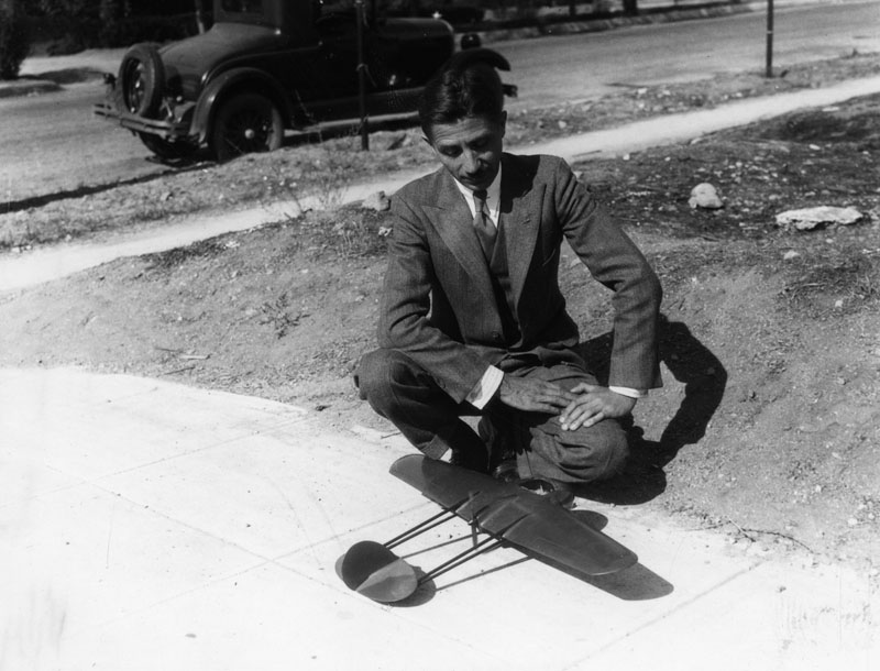 Tony Stadlman with a prototype model of the flying wing airplane, made for Northrop.