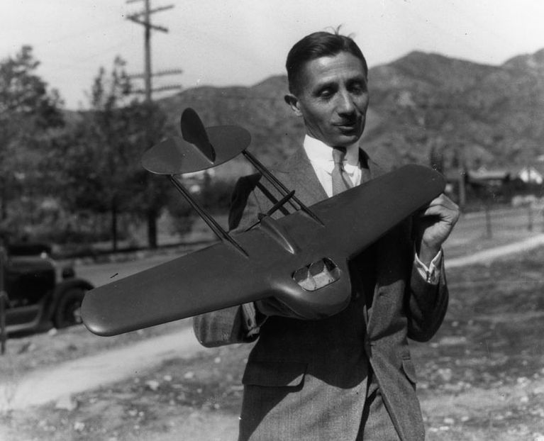 Tony Stadlman, designer of the flying wing, with a prototype model. It was built for Northrop.