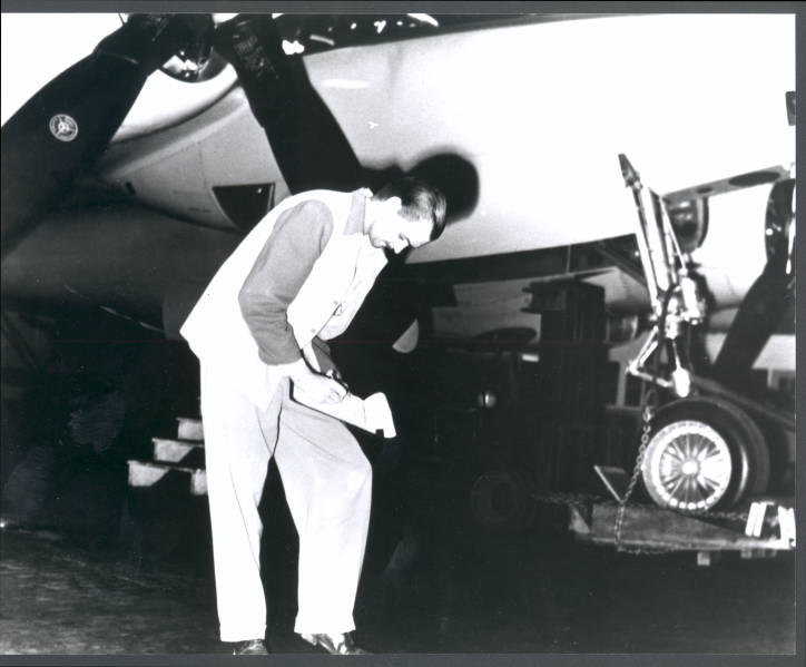 Photograph of Howard Hughes with the second XF-11, April 3, 1947