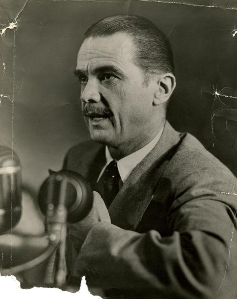 Howard Hughes speaks into a microphone as he testifies before the Senate War Investigating Committee, August 6, 1947, in Washington, D.C..jpg
