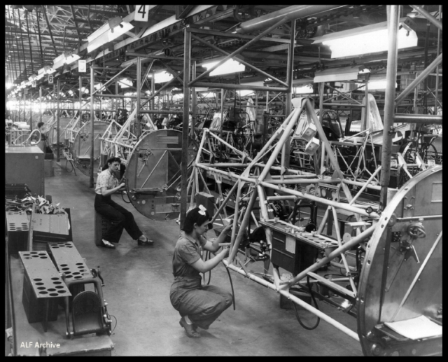"""Above- Women aircraft assembly workers at Vultee's Downey plant. """"Rosie the Riveters""""."""