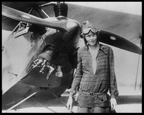 """Above-    Amelia Earhart    in front of her first airplane, a Kinner """"Airster"""", c. 1921"""