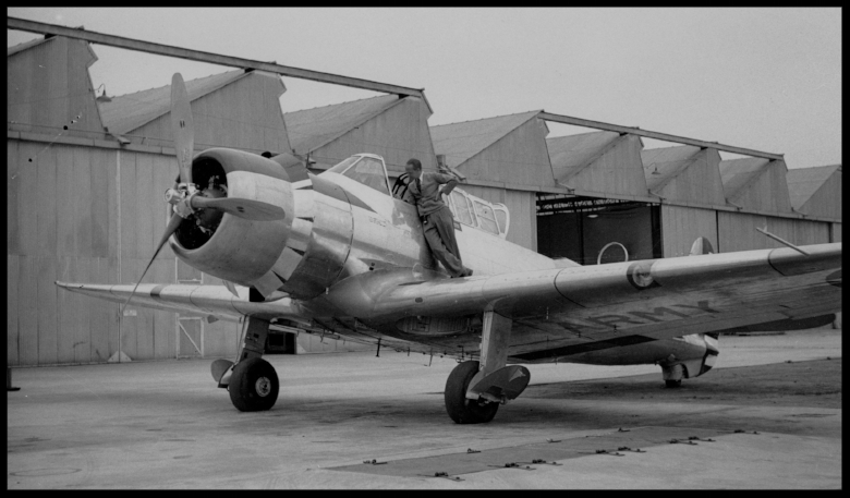 """Above- Vultee YA-19, later the V-11 pre 1940 in Downey, California at Vultee Aircraft. """"The Vultee V-11, retained the single-engined, low wing format and all-metal stressed skin structure of the V-1. It combined a new fuselage with accommodation for the two or three crew members under a long greenhouse canopy with the wings and tail surfaces of the Vultee V-1"""".  Wiki"""