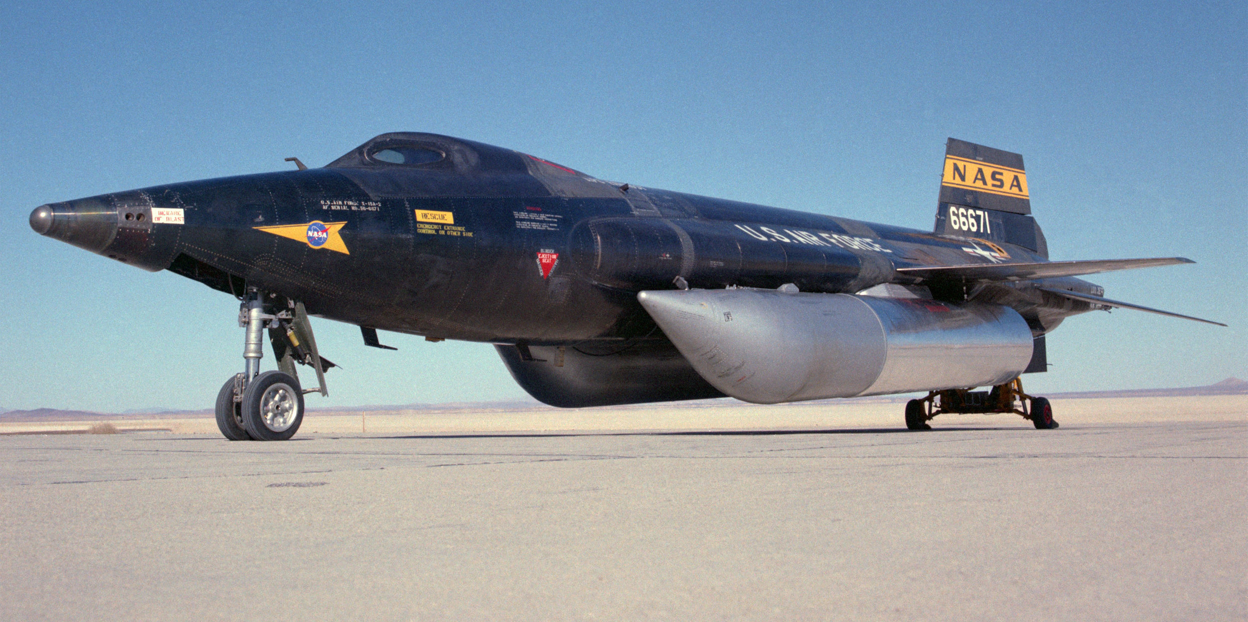 Above- The second X-15 rocket plane (56-6671) is shown with two external fuel tanks which were added during its conversion to the X-15-A-2 configuration in the mid-1960's. (NASA)