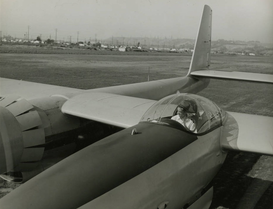 Photograph of Howard Hughes in the cockpit of the first XF-11