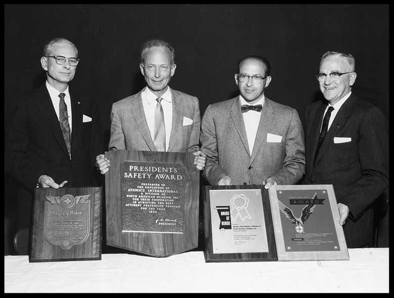 Above-  J une 5, 1959 reads, Dr. Chauncey Starr, second from right, vice president of North American Aviation and general manager of Atomics International accepts safety award. Lee Atwood, second from left.